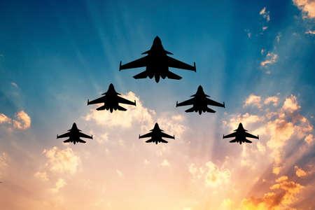 warplanes at sunset Banque d'images - 110919480