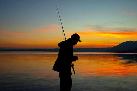 illustration of man fishing at sunset Stock Photo