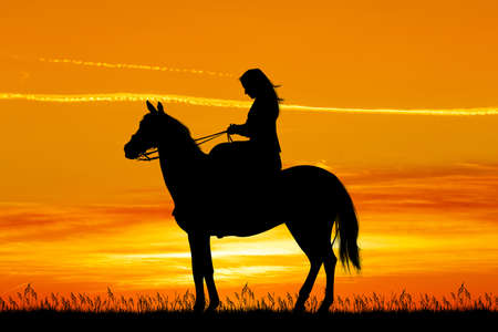 girl on horse at sunset