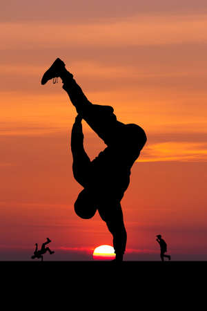 illustration of breakdance performer at sunset Stock Photo
