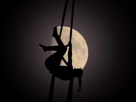 aerial acrobatic in the moonlight