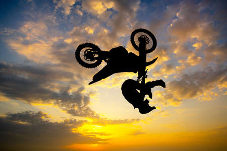 freestyle motocross at sunset Фото со стока