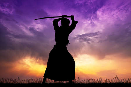 samurai with katana at sunset