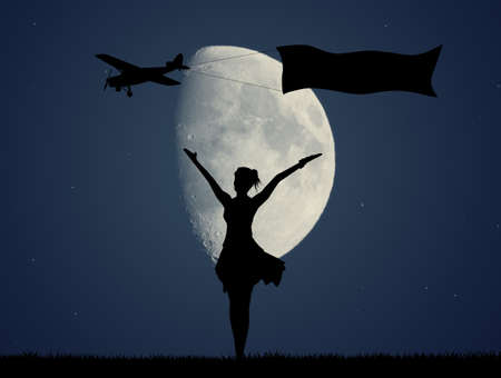 girl and airplane with banner in the moonlight