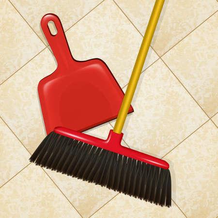 scopa con paletta sul pavimento