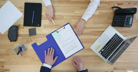 autograph: Businessman signing a contract with desktop and paperwork on background, top view. Stock Photo