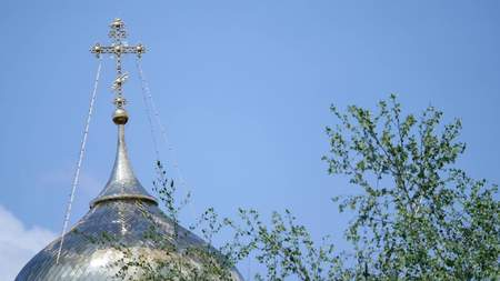Eastern orthodox crosses on gold domes (cupolas) against blue cloudy sky. Stock Photo