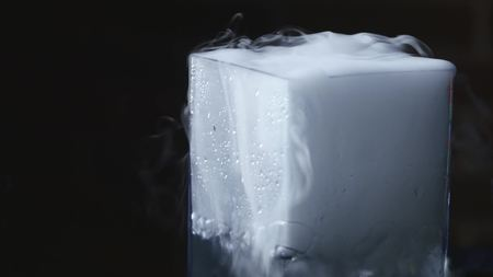 drink in glass with the effect of dry ice.