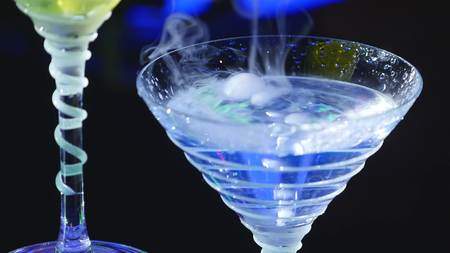 low temperature: drink in glass with the effect of dry ice. barman show.