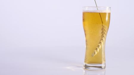 real ale: wheat on a glass of beer on a white background.