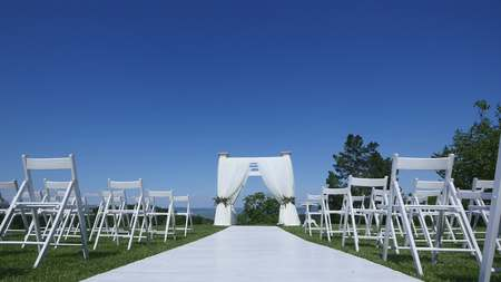 Dolly of rows of chairs at a wedding ceremony from the aisle.