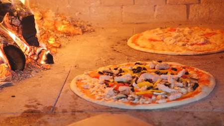 pizza baking in a wood fired oven.