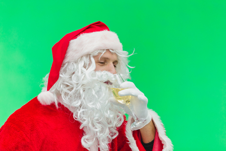 Santa Claus celebrating with champagne. chroma key.