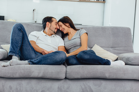 woman and man on the couch Stock Photo