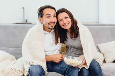 A woman and husband wandering the TV