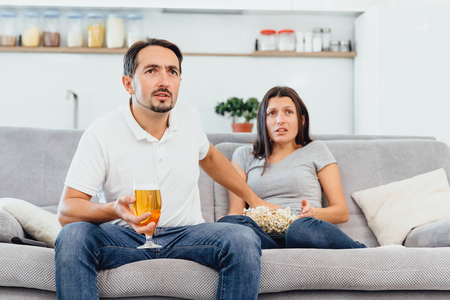 Husband and woman sitting on the couch