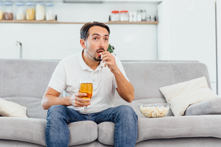 Man with beer and popcorn
