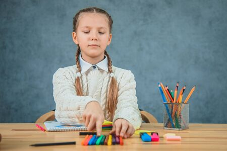 Portrait of a young girl in school at the desk. Stock Photo