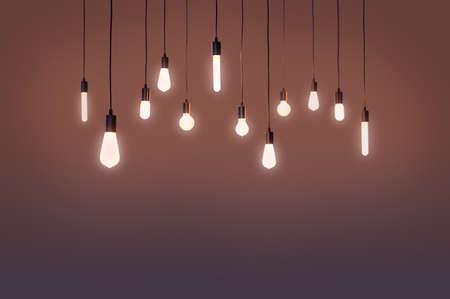 bulbs electric and a light as a concept background color mauve, brown Banco de Imagens