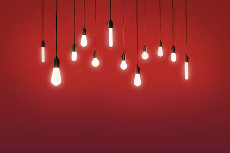 bulbs electric and a light as a concept background color red