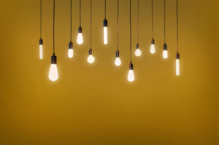 bulbs electric and a light as a concept background color yellow