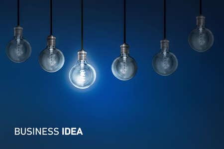Business idea, creativity innovation illuminated light bulb row dim ones concept solution Archivio Fotografico