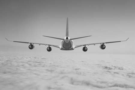 Plane aircraft flying through clouds Stock Photo