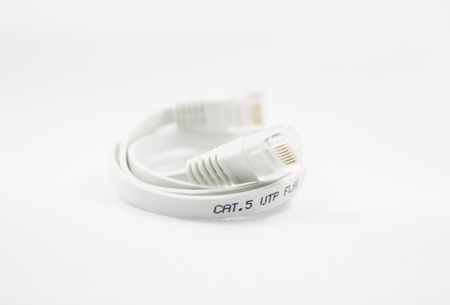 a LAN cable (network cable internet) manifold flat cable with a white background. Stock Photo