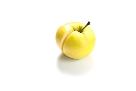 sliced apple: Golden apple on white . Sliced apple. Stock Photo