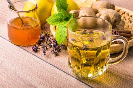 Still life with tea. Natural herbal tea with honey and lemon. Thymus serpillum. photo