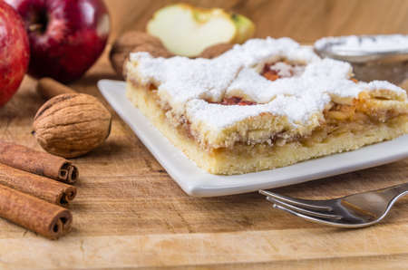 Homemade apple pie with cinnamon, sprinkled with sugar. photo