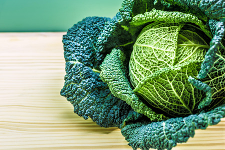 curly kale in the kitchen, excellent vegetables photo