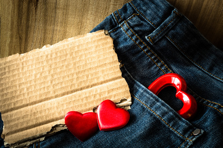 wooden insert: Valentine greeting on blue jeans and wooden background. Insert your text.
