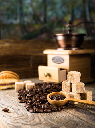 coffee beans with grinder and cane sugar photo