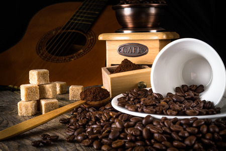 coffee beans with grinder, coffee cup and cane sugar photo