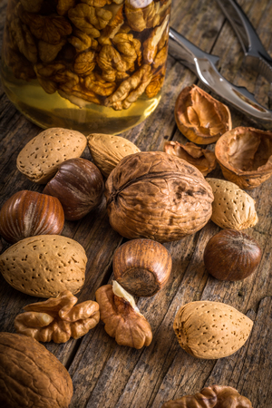 steel nutcracker and nuts of various kinds, nuts in honey