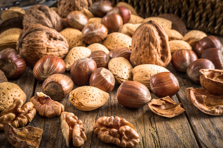 heap of different kinds of nuts in shell