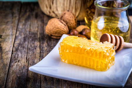 honey cell: honey dipper and honeycomb, nuts in honey and nuts of various kinds,