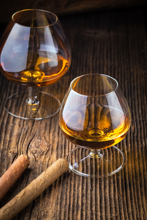 habana: quality cigars and cognac on an old wooden table Stock Photo