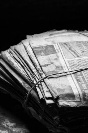 newspaper texture: a pile of old newspapers tied with twine Stock Photo