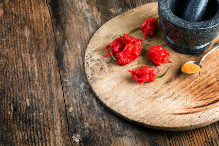 strongly: very strongly hot pepper Carolina Reaper or HP22B Stock Photo