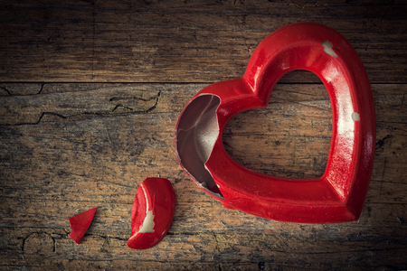 chagrin: Valentine broken heart on a vintage wooden background Stock Photo