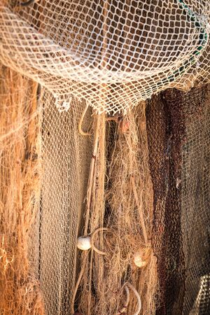 fishing floats: Old fishing net in the harbor with cork floats Stock Photo