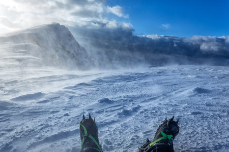 alpinism: snow crampons - equipment for extreme excursions to the mountains