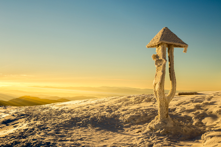 wooden trail sign: Tourist sign in the winter morning sun rays Stock Photo