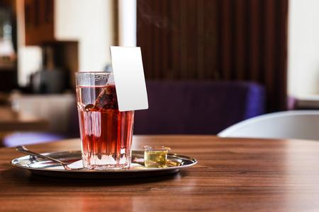 rec: Red fruit tea in tearoom. Nobody.Waiting for friends.