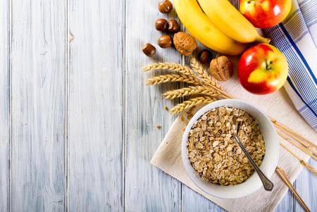 oatmeal: Oatmeal with apple, banana, grape chocolate. Bowl of fresh fruit.
