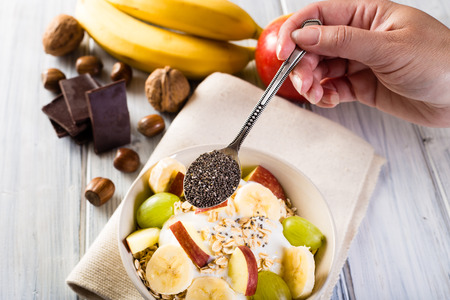 breakfast bowl: Oatmeal with chia seeds. Bowl of cereal. Stock Photo