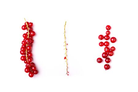 detail of bunch: Detail bunch of red currants with a stem on a white background. Healthy fruit with antioxidant.