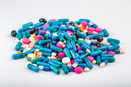 Medication with different types and colours. Tablets and pils. Scattered pills.